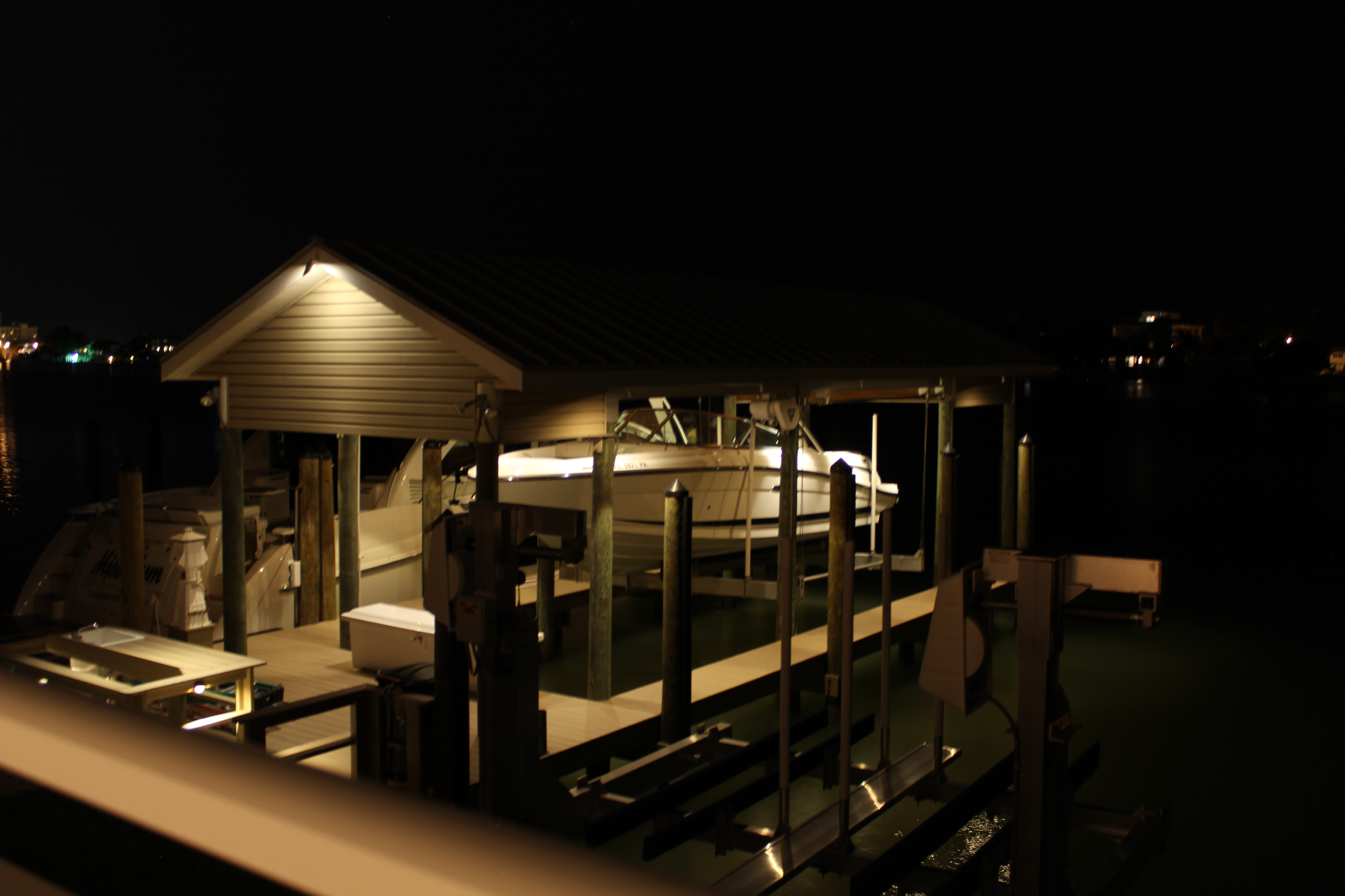 a boat on a deck at night with light